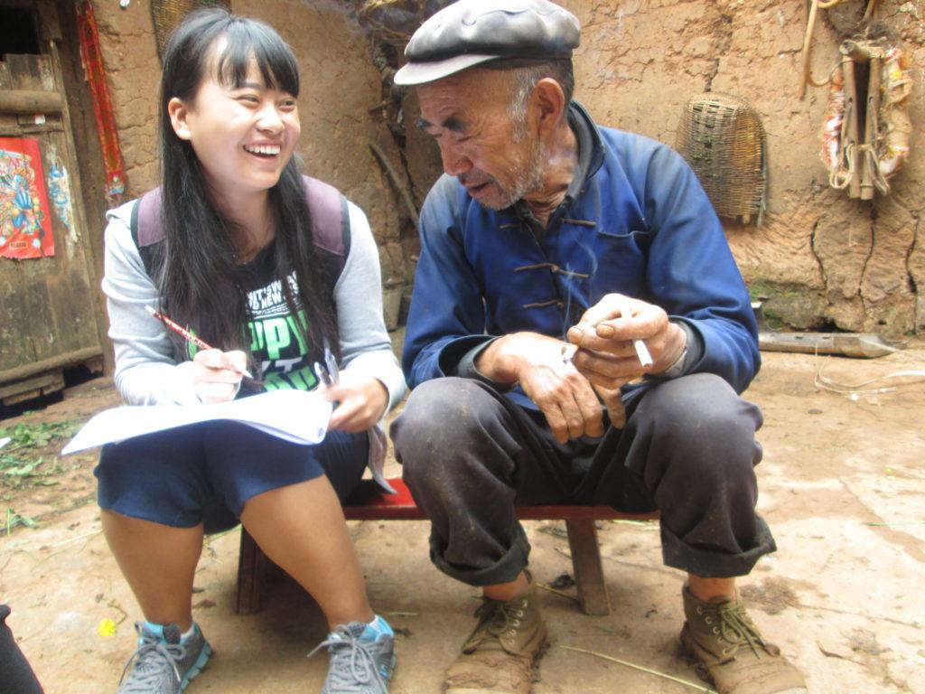 Junhong Qin, Research Assistant, CIP, surveys a local potato farmer.